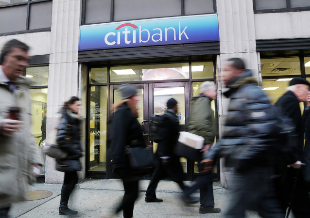 People walk past a branch office of Citibank, Thursday, Jan. 15, 2015, in New York