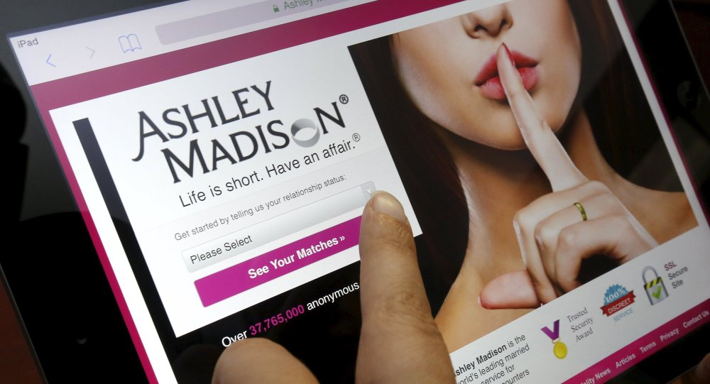 The homepage of the Ashley Madison website is displayed on an iPad, in this photo illustration taken in Ottawa, Canada July 21, 2015