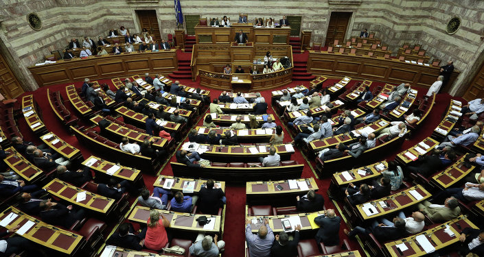 Lawmakers take part in a parliamentary session in Athens, Friday, Aug. 14, 2015.