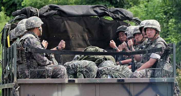 South Korean soldiers ride in the back of a military vehicle in the border county of Yeoncheon on August 22, 2015
