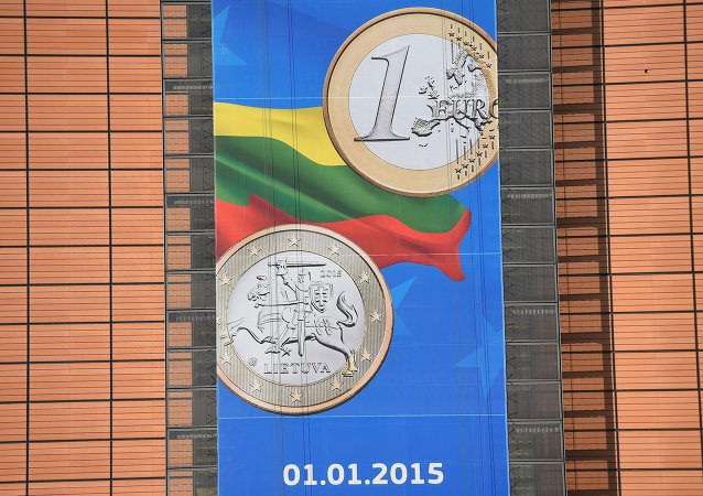 A picture shows a detail of a banner welcoming Lithuania into the Eurozone hung on the European Commission headquarters in Brussels on January 5, 2015