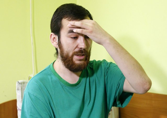 A man, who according to Ukraine's state security service (SBU) is named Yevgeny Yerofeyev and is one of two Russian servicemen detained on May 17 by Ukrainian forces, answers reporter's questions at a hospital in Kiev, Ukraine, July 28, 2015