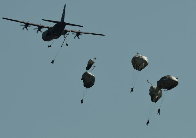 A multinational brigade of paratroopers take part in the Swift Response airborne training exercise in Hohenfels, southern Germany on August 26, 2015