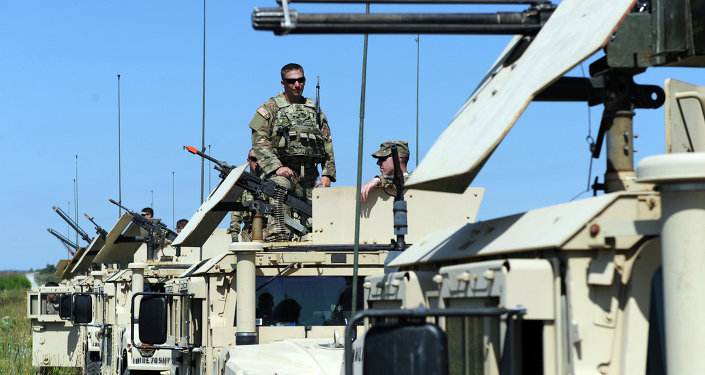 US servicemen stand on humvees with mounted machine guns as they take part in a military drill in Yavoriv polygon, Lviv district, western Ukraine, on July 22, 2015