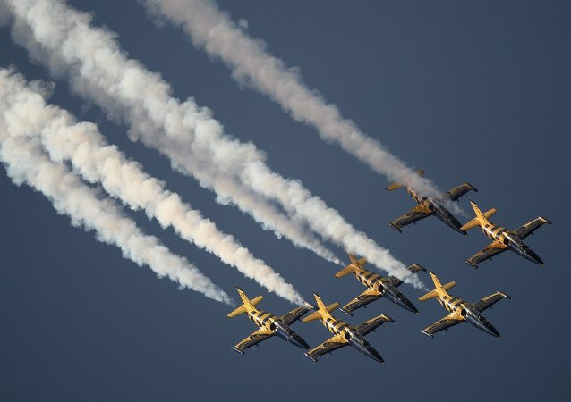 Aero L-39 Albatros jet trainers of the Rus aerobatic display team perform during the International Aerospace Salon (MAKS 2015) in Zhukovsky near Moscow