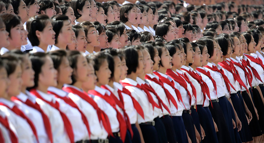 A North Korean student choir sing as part of the celebrations for the anniversary of the Korean War armistice agreement, Sunday, July 27, 2014, in Pyongyang, North Korea