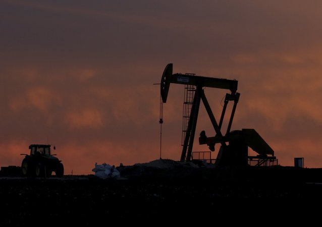 A well pump works at sunset on a farm near Sweetwater, Texas, Monday, Dec. 22, 2014