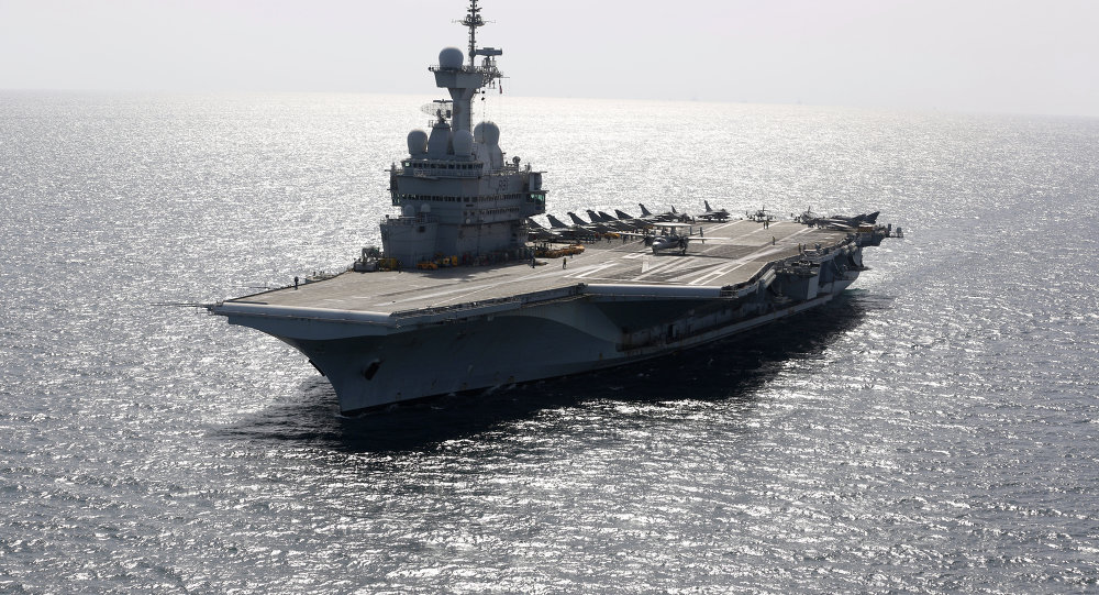 A French Navy HawEye prepares to take off from the aircraft carrier Charles de Gaulle operating in the Gulf on February 26, 2015