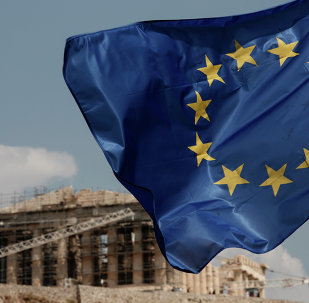 A European Union (EU) flag flutters in front of the temple of the Parthenon in Athens, Greece, Saturday, Aug. 15, 2015