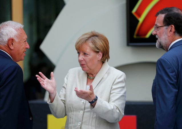 German Chancellor Angela Merkel, Spanish Prime Minister Mariano Rajoy (R) and Spanish Foreign Minister Jose Manuel Garcia-Margallo arrive for a German-Spanish business meeting in Berlin, Germany