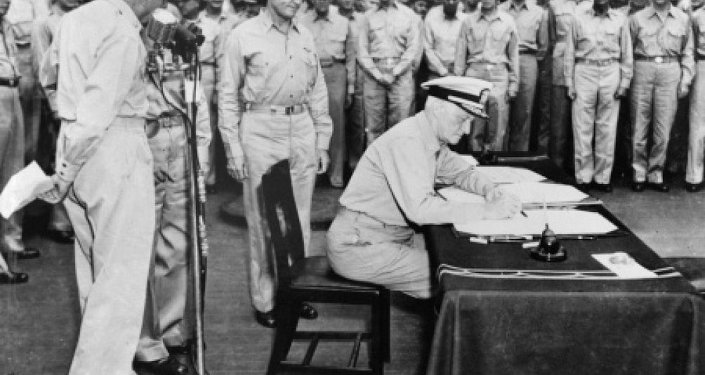 Admiral Chester Nimitz, representing the United States, signs the instrument of surrender.