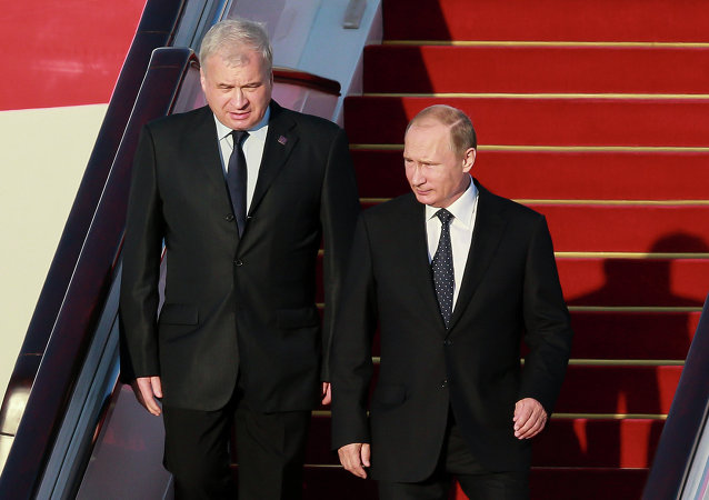 Russian President Vladimir Putin, right, during a welcome ceremony in Beijing airport. Left - Russian Ambassador to China Andrei Denisov.