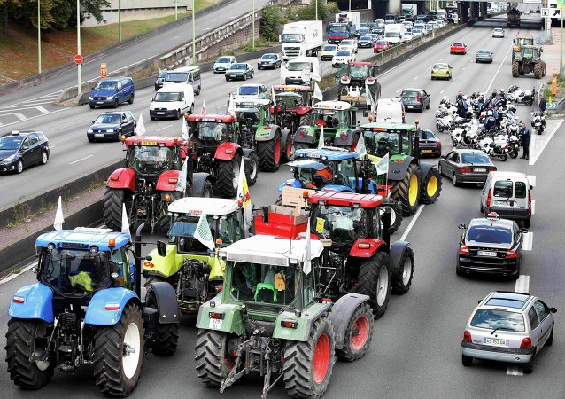 French farmers converge on Paris, driving their tractors on the motorway, outside Paris, France, September 3, 2015