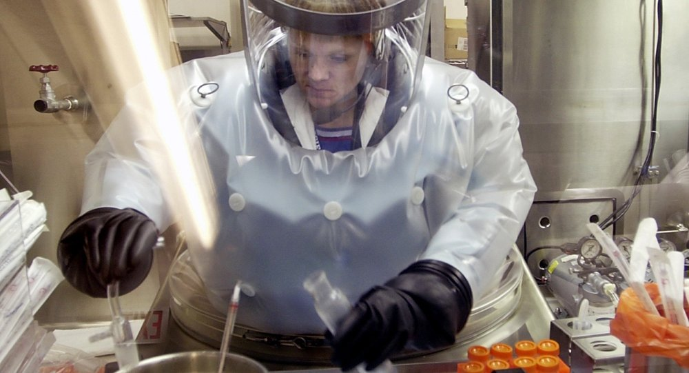 FILE - In this May 11, 2003, file photo, Microbiologist Ruth Bryan works with BG nerve agent simulant in Class III Glove Box in the Life Sciences Test Facility at Dugway Proving Ground, Utah. The specialized airtight enclosure is also used for hands-on work with anthrax and other deadly agents