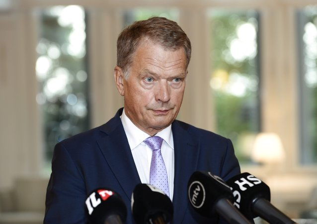 Finnish President Sauli Niinisto speaks to media in Helsinki, Finland on Thursday, Aug. 14, 2014