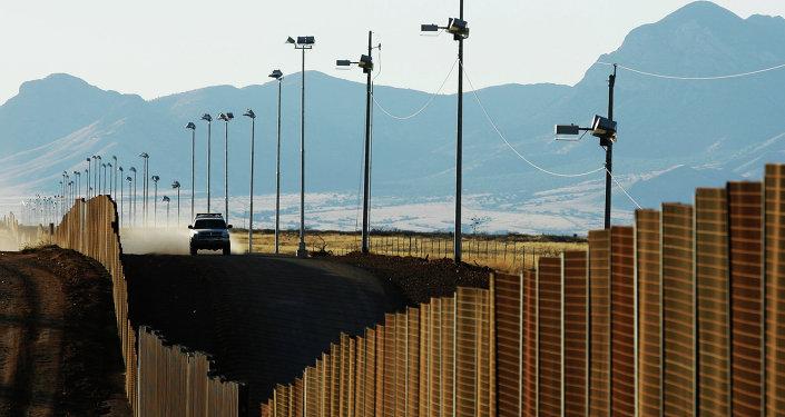 US border patrol vehicle rides along the fence at the US-Mexican border near Naco, Mexico, Sunday, Jan. 13, 2008