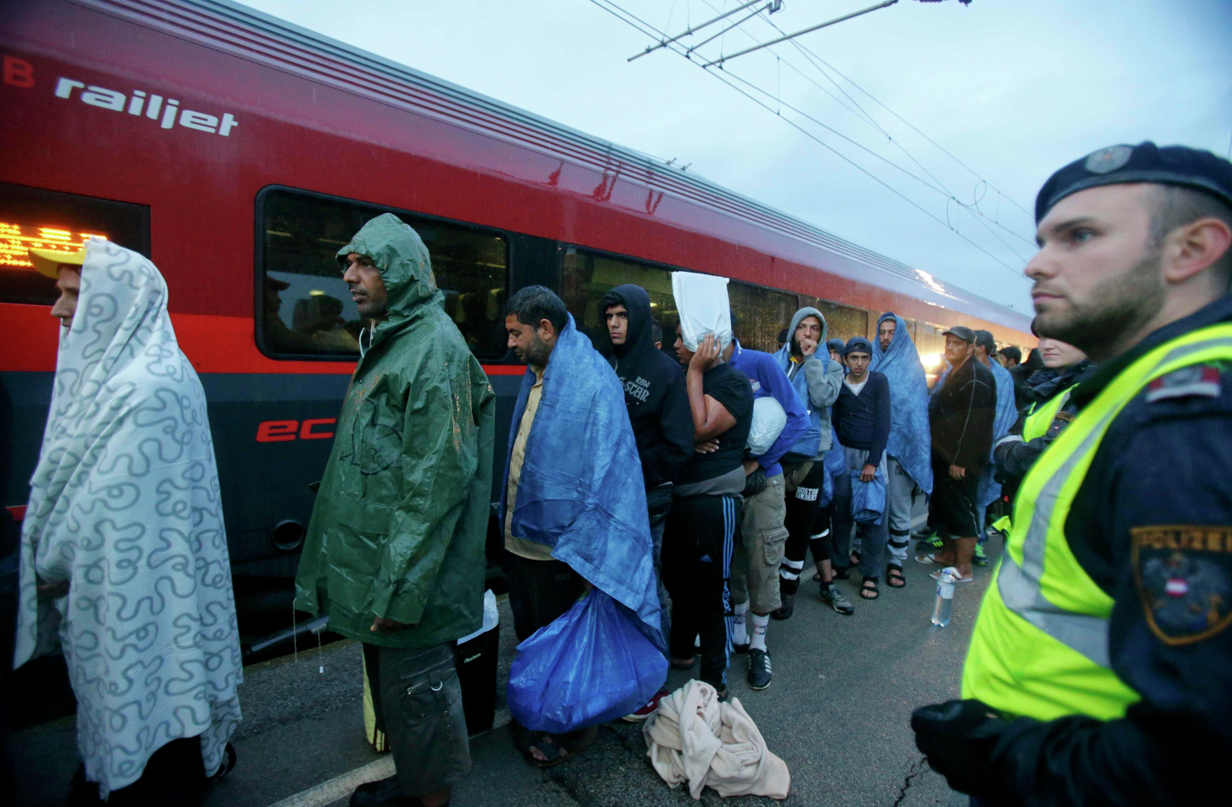 Migrants board a train to Germany at the Austrian train station of Nickelsdorf, September 5, 2015