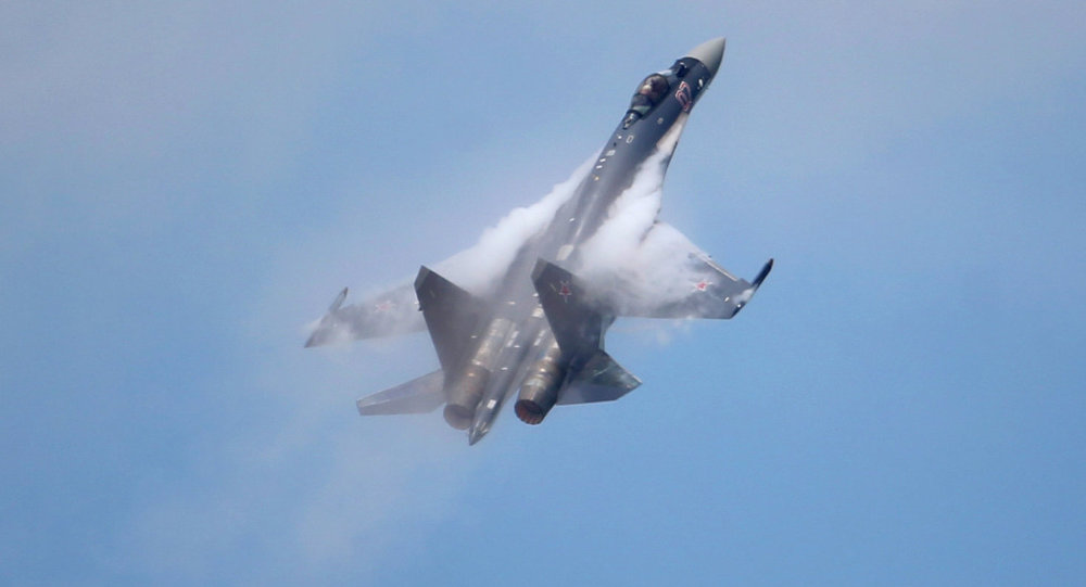 A Sukhoi Su-35 jetfigther performs its demonstration flight during the 50th Paris Air Show at Le Bourget airport, north of Paris, Thursday, June 20, 2013.