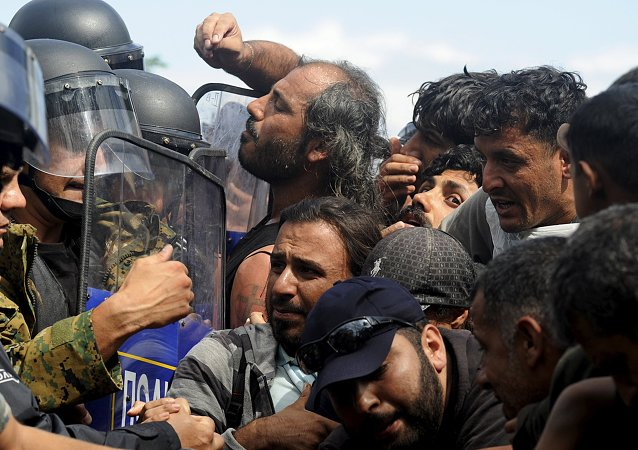 Migrants are blocked by Macedonian special police forces as they try to cross Greece's border into Macedonia, near the village of Idomeni, Greece, August 22, 2015
