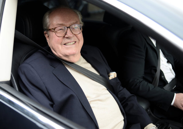 France's far-right party Front National (FN) honorary president Jean-Marie Le Pen smiles as he leaves the party's headquarters in Nanterre, near Paris