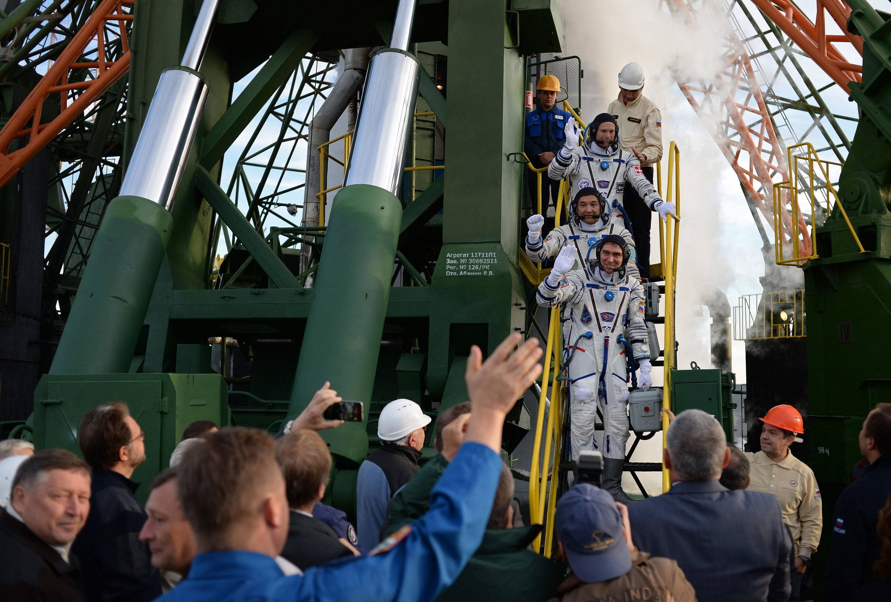 Crew members of the long-term expedition 45/46 to the ISS and visiting expedition 18, top to bottom: ESA astronaut Andreas Mogensen, Kazakh cosmonaut Aidyn Aimbetov and Roscosmos cosmonaut Sergei Volkov before the launch of Soyuz TMA-18M spacecraft with crew of long-term expedition 45/46 to the International