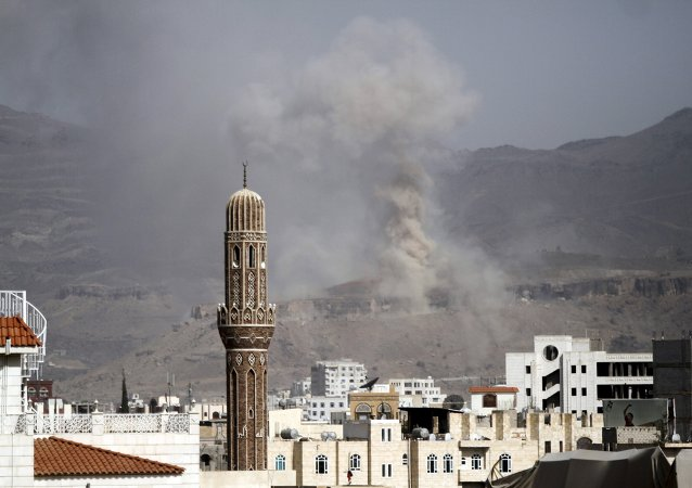 Smoke rises during an air strike on an army weapons depot on a mountain overlooking Yemen's capital Sanaa September 5, 2015