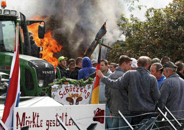 Farmers and dairy farmers from all over Europe take part in a demonstration outside an European Union farm ministers emergency meeting at the EU Council headquarters in Brussels, Belgium September 7, 2015.