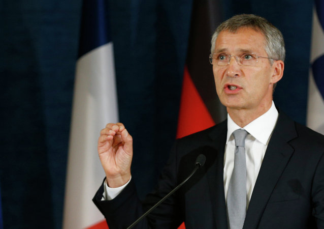 NATO Secretary General Jens Stoltenberg, left, addresses the media at a news conference at the NATO Force Integration Unit Headquarters in Vilnius, Lithuania, Thursday, Sept. 3, 2015.