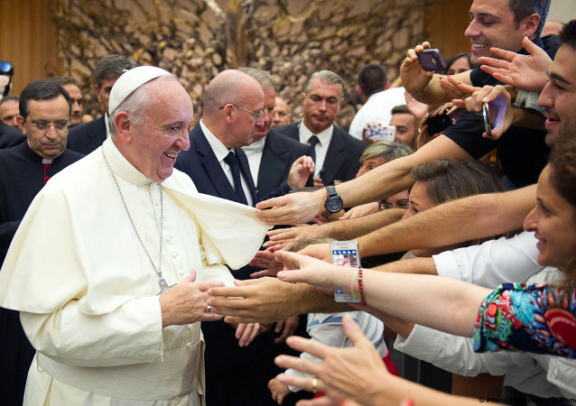 Pope Francis greets faithful during an audience to Parish groups promoting evangelization, in the Paul VI hall at the Vatican, Saturday, Sept. 5, 2015.
