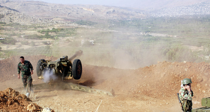 Syrian troops shoot at the Islamist forces' positions near Al-Zabadani in Syria