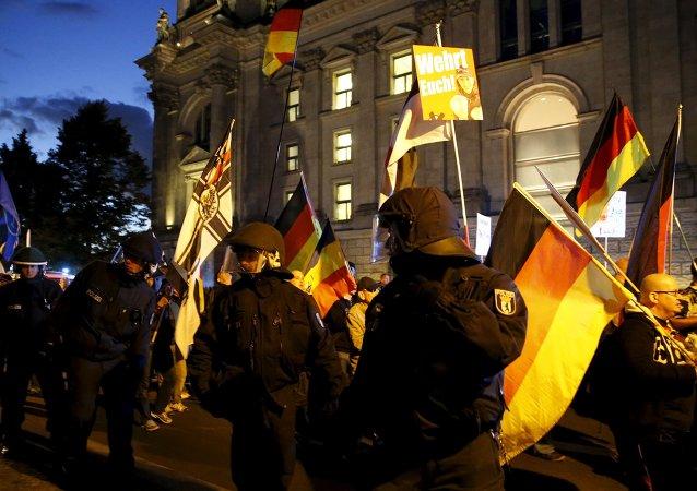 German police officers escort members of rally in Berlin, Germany September 7, 2015