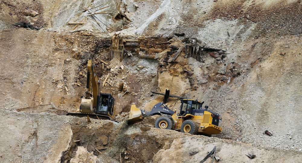 Environmental Protection Agency contractors repair damage at the site of the Gold King mine spill of toxic wastewater, outside Silverton, Colo., Wednesday, Aug. 12, 2015