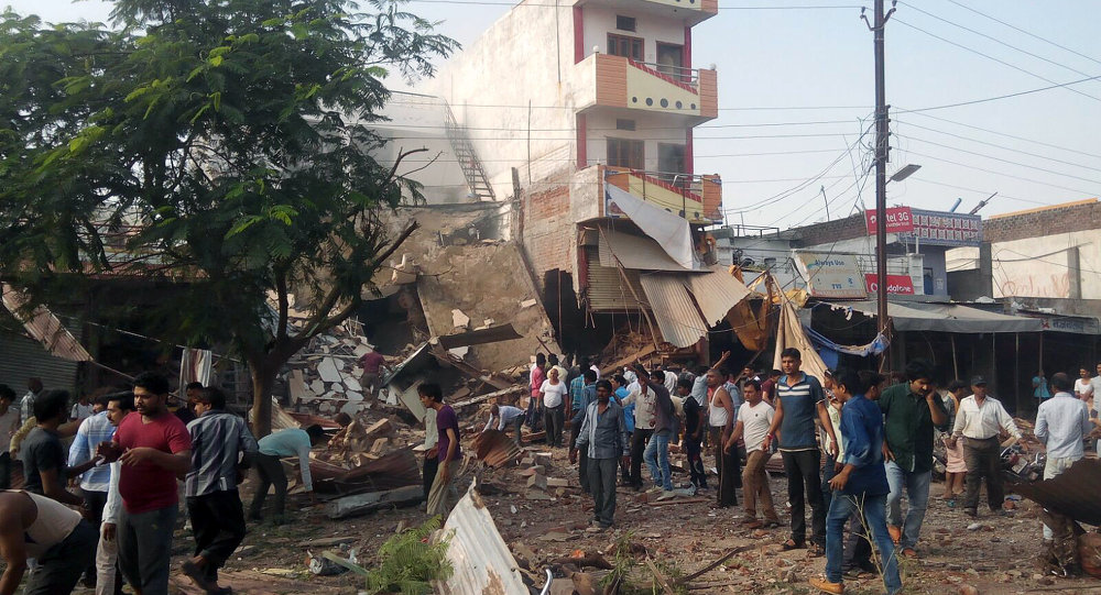 People gather around the site of an explosion at a restaurant in Jhabua district in the central Indian state of Madhya Pradesh on September 12, 2015