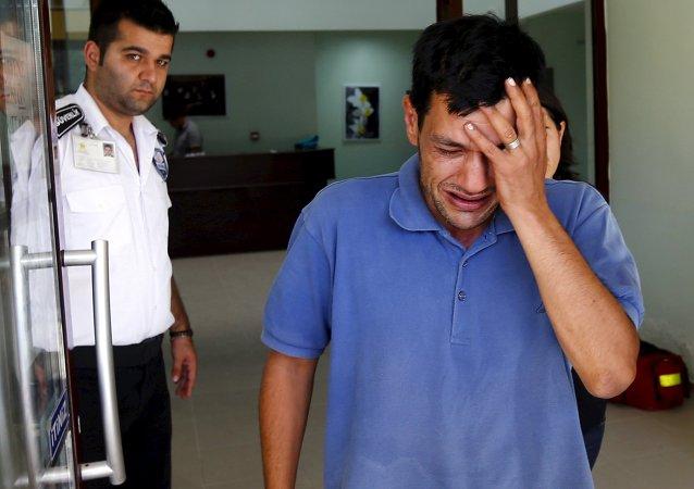 Abdullah Kurdi, father of three-year old Aylan Kurdi, cries as he leaves a morgue in Mugla, Turkey, September 3, 2015