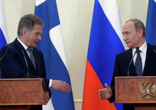 Russian President Vladimir Putin, right, and Finnish President Sauli Niinisto greet each other at a joint news conference in the Novo-Ogaryovo residence outside Moscow, Russia, Tuesday, June 16, 2015