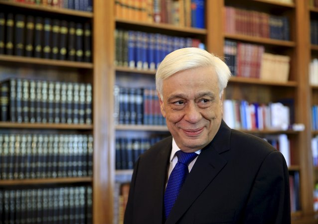 Greek President Prokopis Pavlopoulos looks on before a meeting with Popular Unity far-left leader Panagiotis Lafazanis (unseen) at the Presidential Palace in Athens, GreeceAugust 27, 2015
