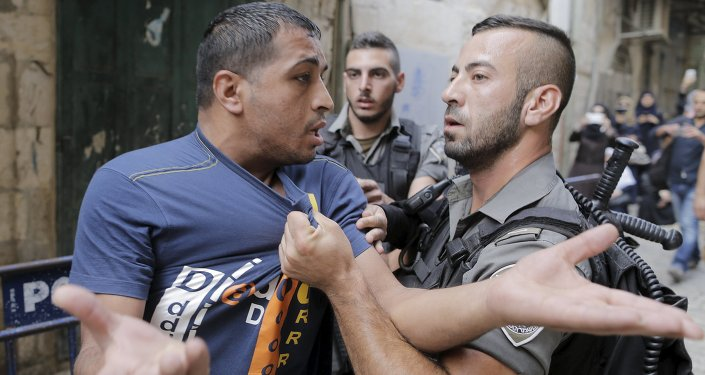 Israeli border police officers detain a Palestinian protester in Jerusalem's Old City