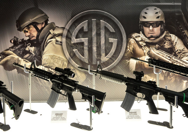 Weapons are displayed at the Defence and Security Equipment International (DSEI) arms fair at the ExCeL centre in east London, on September 10, 2013.
