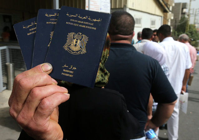 Syrian man holds his family's passports