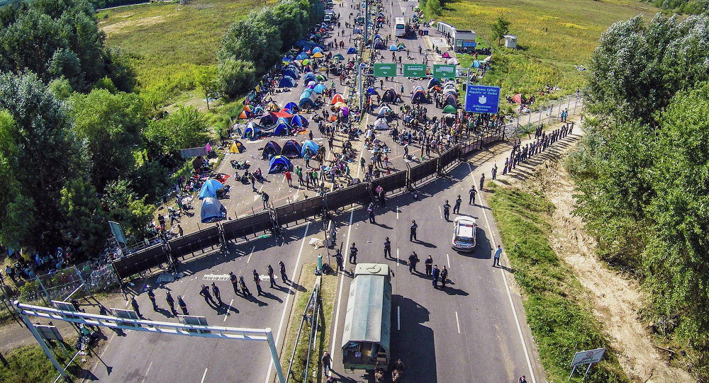 An aerial view taken on September 16, 2015 shows migrants camping on no-man's land of the border between Hungary and Serbia near Roeszke