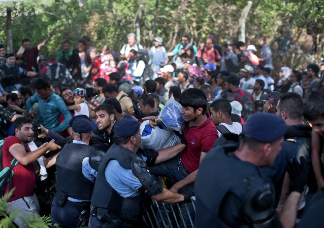 People push through a police line in Tovarnik, Croatia, Thursday, Sept. 17, 2015