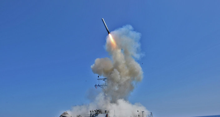 The guided missile destroyer USS Barry (DDG 52) launches a Tomahawk cruise missile
