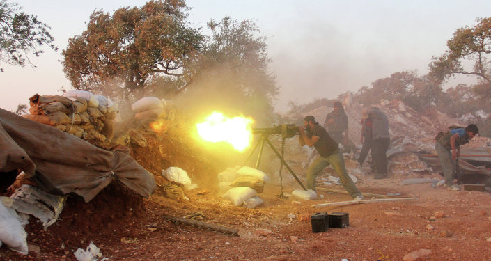 A rebel fighter fires heavy artillery during clashes with government forces and pro-regime shabiha militiamen in the outskirts of Syria's northwestern Idlib province on September 18, 2015