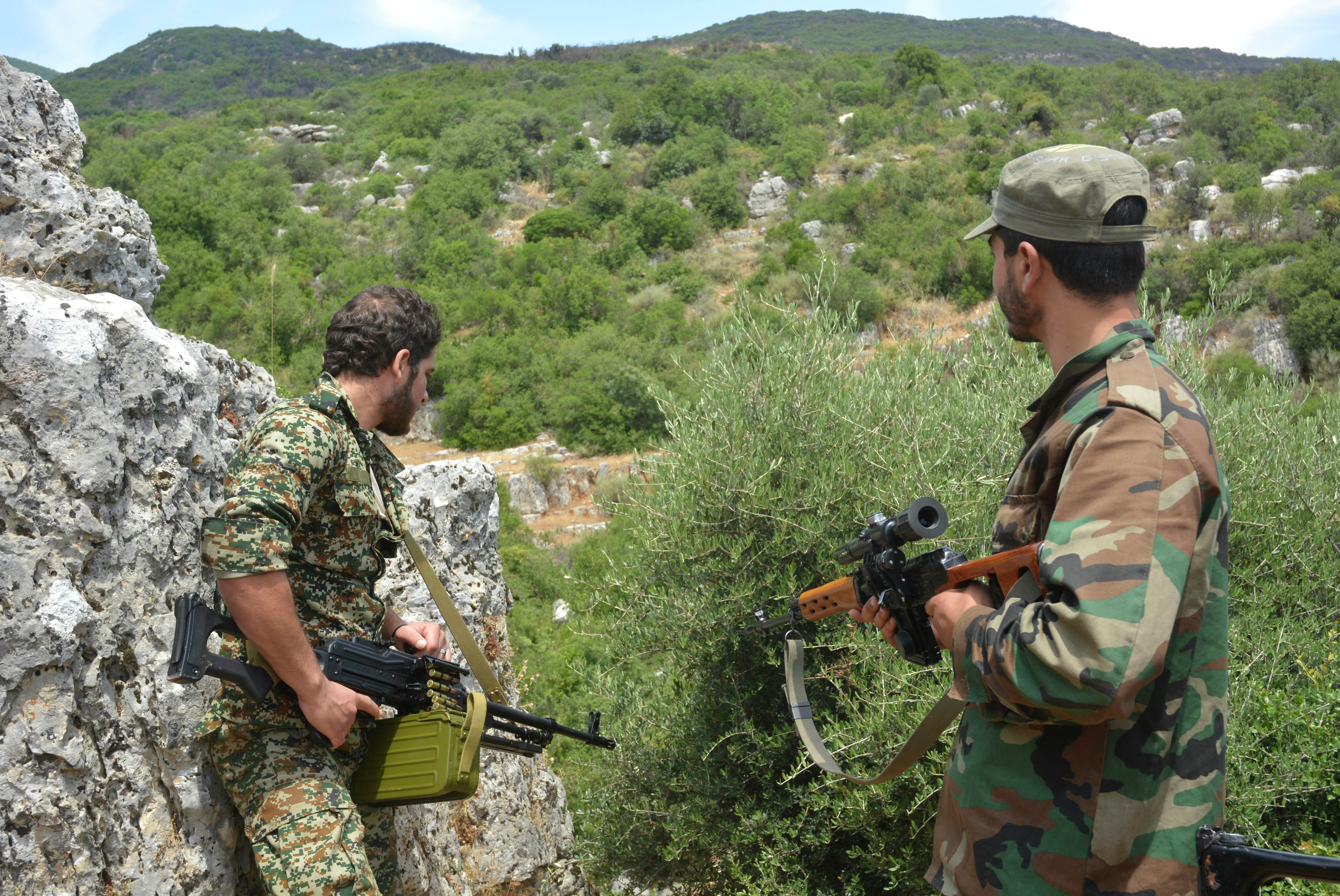 Syrian pro-government forces patrol an area in the Sahl al-Ghab, in Hama province, on June 7, 2015