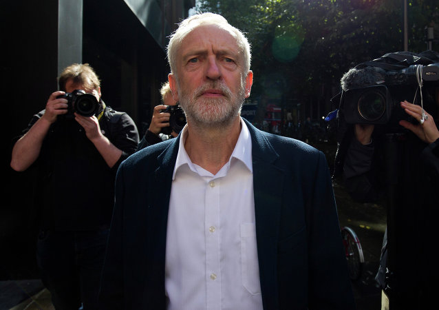 Newly elected leader of Britain's opposition Labour party Jeremy Corbyn leaves the Party's headquarters in London on September 14, 2015.