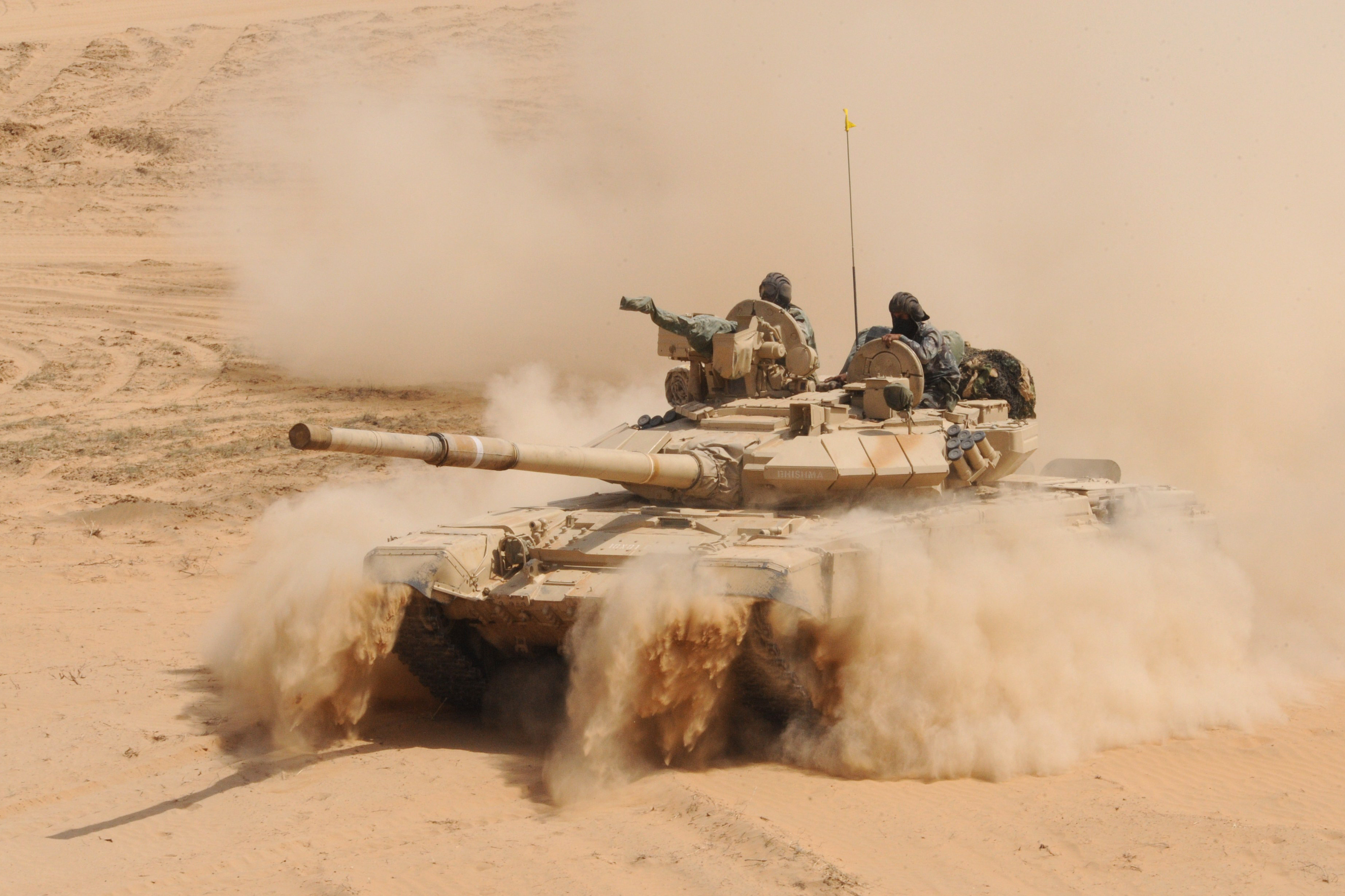 An Indian Army T-90 battle tank kicks up dust during the Shoor Veer military exercise near Hanumangarh, located near the India-Pakistan border, 2012.