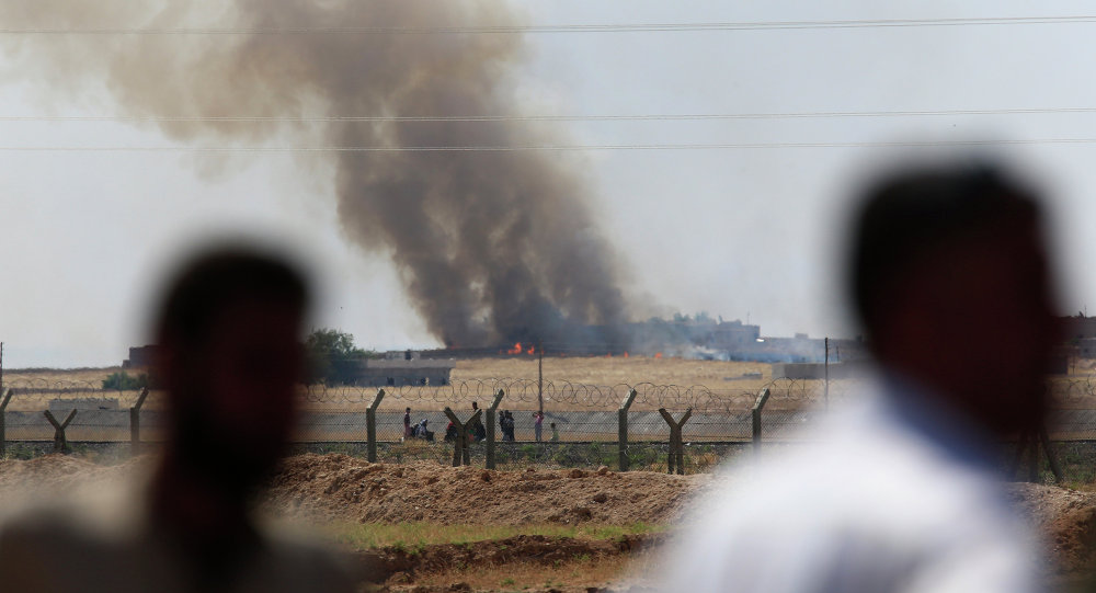 People watch as smoke from a US-led airstrike rises over the outskirts of Tal Abyad, Syria.