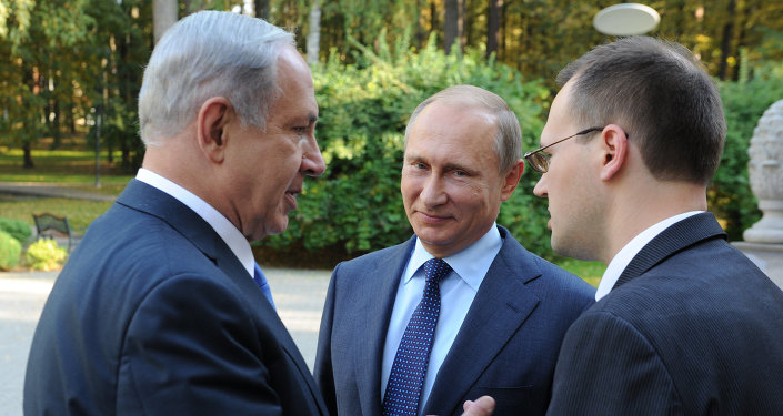 Russian President Vladimir Putin, center, listens to Israeli Prime Minister Benjamin Netanyahu, left, during their meeting in Novo-Ogaryovo residence just outside Moscow, Russia, on Monday, Sept. 21, 2015