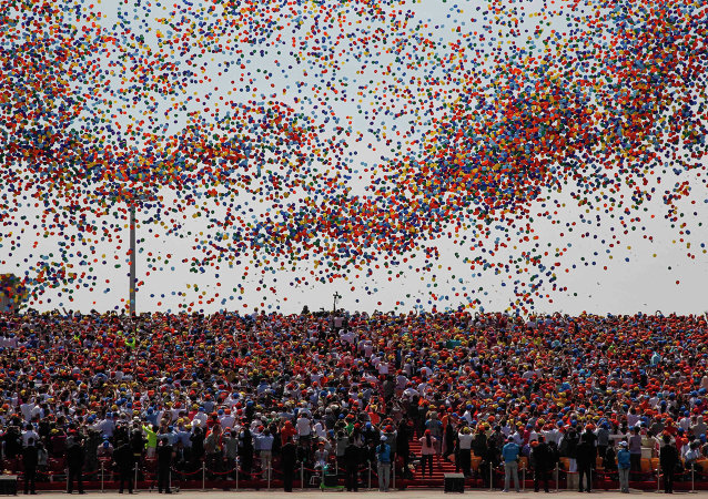 File Photo: Balloons are released as a crowd looks up during a military parade over Tiananmen Square in Beijing on September 3, 2015, to mark the 70th anniversary of victory over Japan and the end of World War II