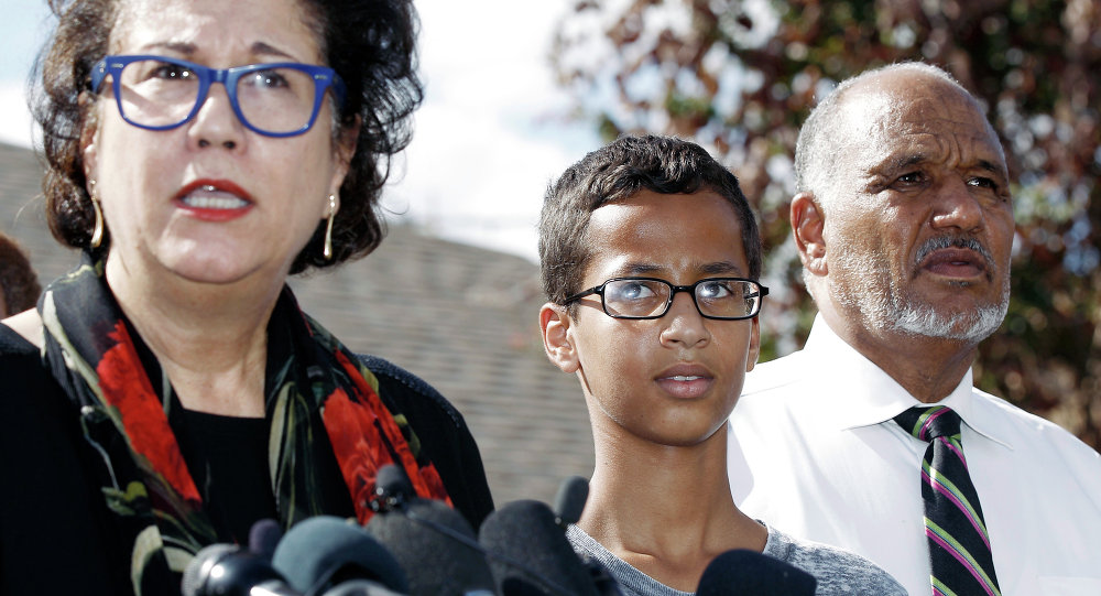 Ahmed Mohamed, 14, center, and his father Mohamed Elhassan Mohamed, right, look on as their attorney Linda Moreno, left, delivers a statement about the arrest of Ahmed during a news conference, Wednesday, September 16, 2015, in Irving, Texas